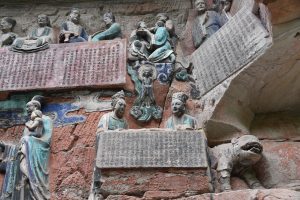 "The lower center shows the depiction of the Mahāsattva jātaka in the ""Filial Piety"" Tableau (no.17) of the Baoding-shan site near Dazu"